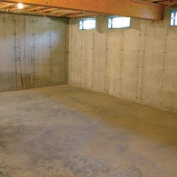 A cleaned out basement in Escanaba, shown before remodeling has begun