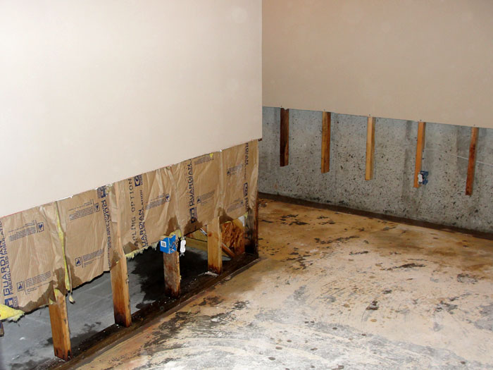 Once the drywall has been cut away and all other damaged wood studs insulation have Basement Wall Restoration Drywall Repair In Michigan