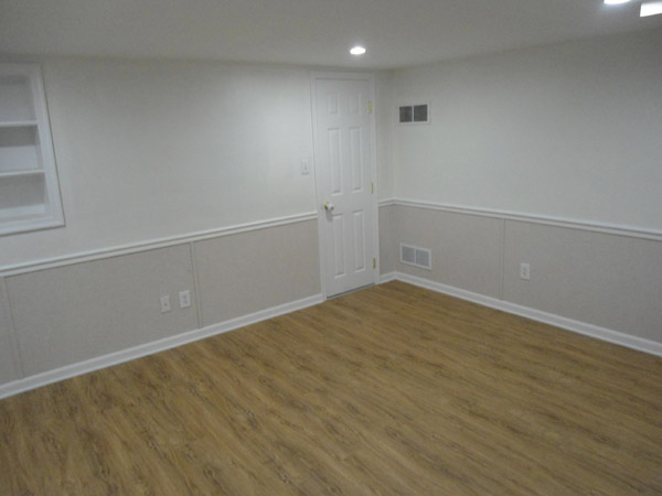 basement wall panels. Our complete EverLast  Finished Wall Restoration System installed in a basement with floor Basement Drywall Repair In Michigan and