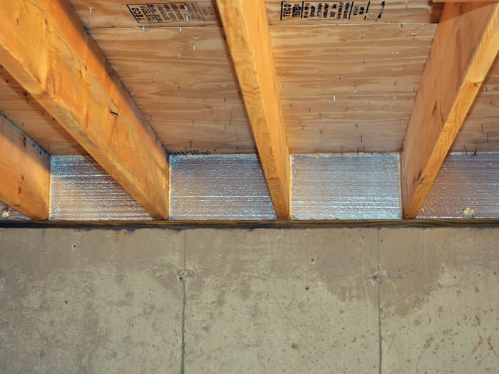 Silverglo Insulation Installed In A Floor Joist Woodruff