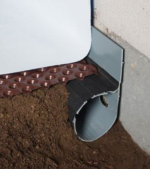 Closeup of a crawl space drainage system installed in Butternut