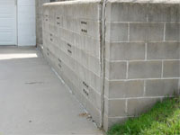 A retaining wall separating from the adjoining walls in Calumet