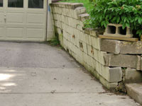 a failing retaining wall around a driveway in Ashland