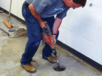 Coring the concrete of a concrete slab floor in Woodruff