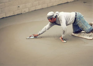 smoothing out the grout in a slab releveling project in Eagle River