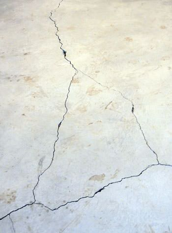 severely cracked, heaving slab floors in a home in Bayfield