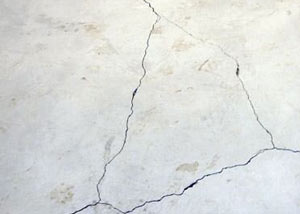 cracks in a slab floor consistent with slab heave in Ontonagon.
