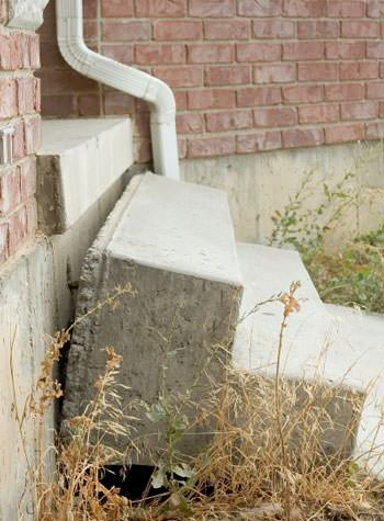 sinking outdoor concrete steps showing cracking and soil washout in Bessemer
