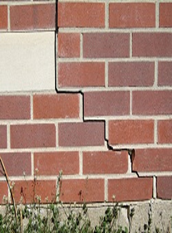 photo of a rotating foundation wall with cracks in Butternut