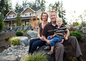 A happy family outside a home with a repaired foundation in Bayfield