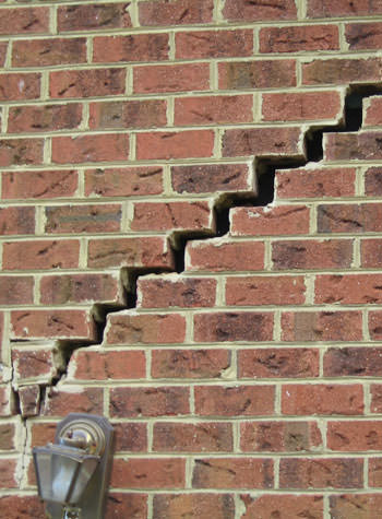 major cracking of a brick foundation wall in Butternut
