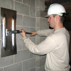 installing a wall anchor to repair an bowing foundation wall in Phillips