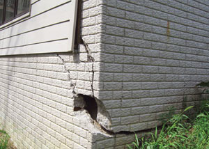 A severely damaged foundation wall in Iron River