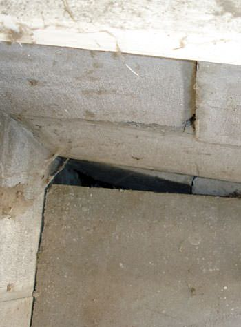 inward rotation of a foundation wall damaged by street creep in a garage in Wakefield