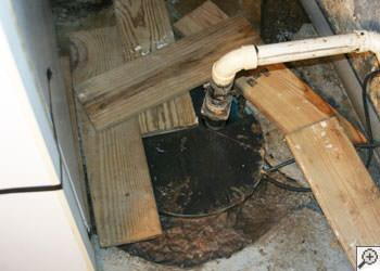 An ugly, clogged sump pump system in Eagle River, Michigan and Wisconsin