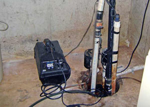 Pedestal sump pump system installed in a home in L'Anse