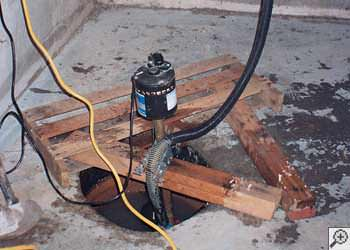 A L'Anse sump pump system that failed and lead to a basement flood.