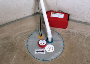 A sump pump system with a battery backup system installed in Chassell