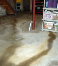 Flooding entering a basement through a floor crack in Lake Linden