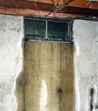 Flooding through basement windows in a Saint Germain home.