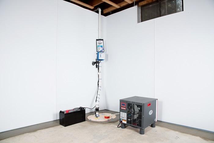 Sump Pump System, Dehumidifier, And Basement Wall Panels Installed During A  Sump Pump Installation