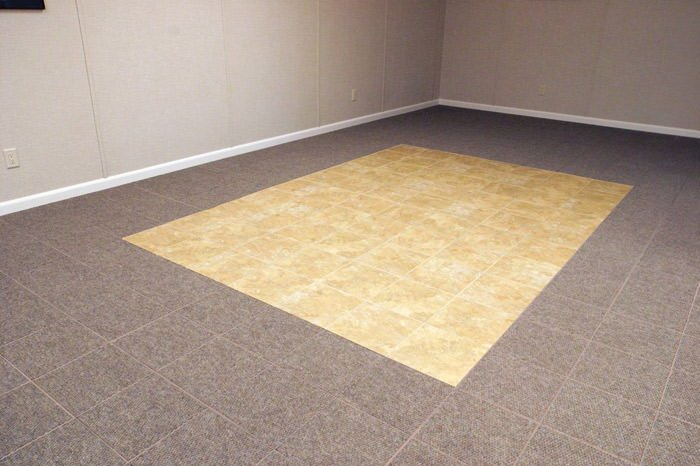 tiled and carpeted basement flooring installed in a Escanaba home