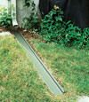 A recessed gutter drain extension installed in Saint Germain, Michigan and Wisconsin