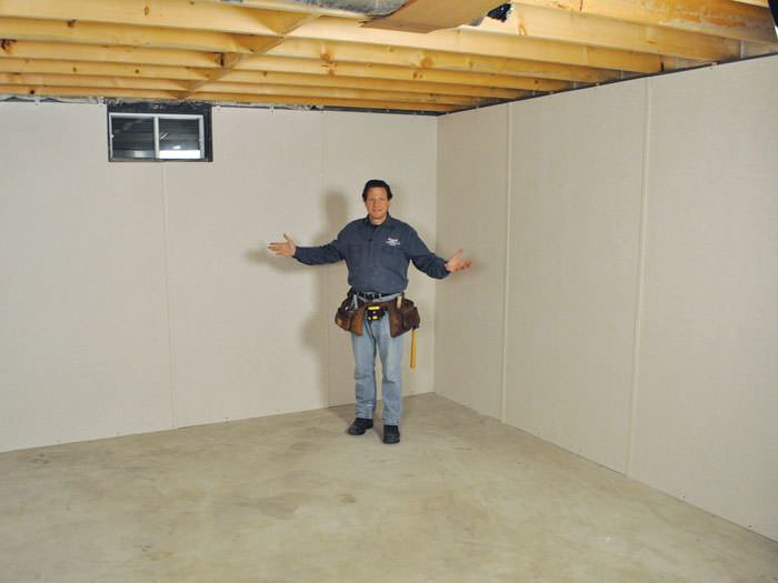 ... Eagle River Basement Insulation Covered By EverLast™ Wall Paneling,  With SilverGlo™ Insulation Underneath